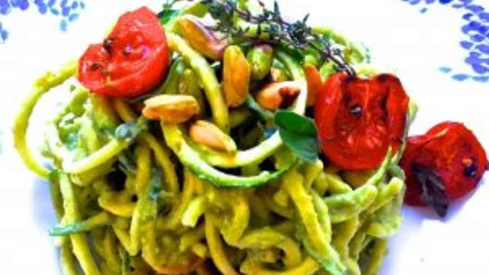 Image of Raw zucchini spaghetti with creamy pistachio sauce and roasted tomatoes