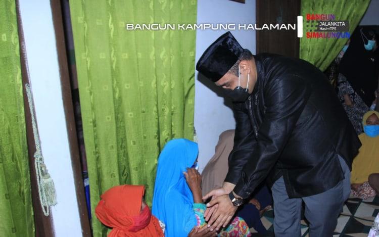 H Muhajidin Nur Hasim  di Perwiritan di Huta 4 Nagori Negeri Bayu, Kecamatan Gunung Malela