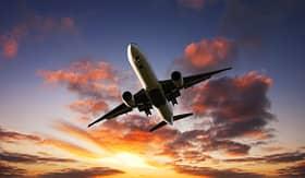 Celebrity Cruises Boeing 777 jet plane flying at sunset