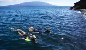 Celebrity Cruises couple snorkeling off the coast