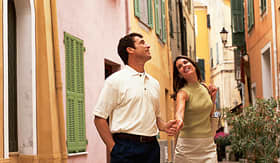 Celebrity Cruises couple strolling down a street in France