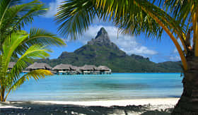 Celebrity Cruises palm trees and huts over the water in bora bora