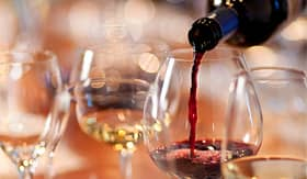 Celebrity Cruises pouring red wine in a glass