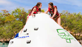 Celebrity Cruises water park with children climbing floating inflatable structure
