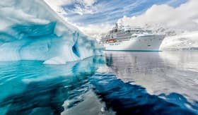 Crystal Endeavor sailing past an iceburg
