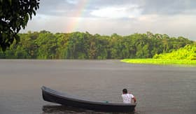 Cunard Line man in a boat with a rainbow in Tortuguero Costa Rica