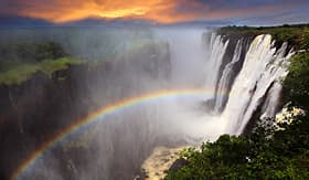 Holland America Line Victoria Falls sunset with rainbow Zambia