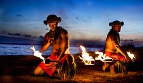 Holland America Line hawaiian men preparing to dance with fire in Maui