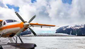Holland America Line seaplane landed near a glacier in Alaska