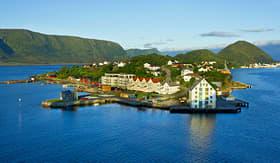 MSC Cruses Alesund Norway houses on the island in summer