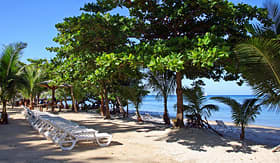 Norwegian Cruise Line Roatan resort beach with lounge chairs in the caribbean