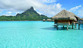 Oceania Cruises overwater bungalow on the tropical island of Bora Bora Tahiti French Polynesia