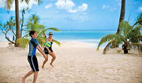 Paul Gauguin guests enjoying white sandy beaches