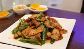 Plate of sichuan style pork and vegetables on Royal Caribbean's Spectrum of the Seas