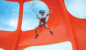 Child with virtual reality helmet jumping on trampoline aboard Royal's Spectrum of the Seas