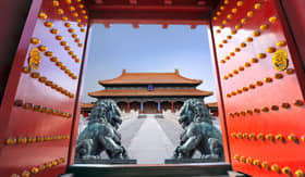 Red entrance gate opening to the forbidden city in Beijing, China