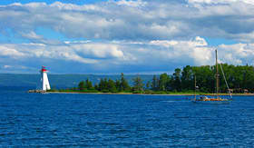 Regent Seven Seas Cruises view of Baddeck Lighthouse and sailboat