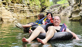 Royal Caribbean family on river tubing adventure