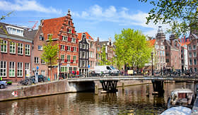 Silversea Cuises bridge and traditional dutch houses Oudezijds Voorburgwal canal Amsterdam Netherlands