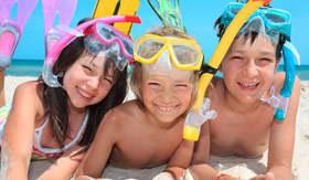 Kids on beach with snorkel gear
