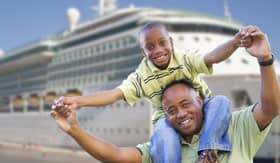Father and son near cruise ship