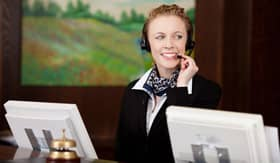 Woman at reservations desk