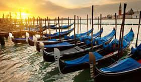 Sunrise behind gondolas in Venice, Italy