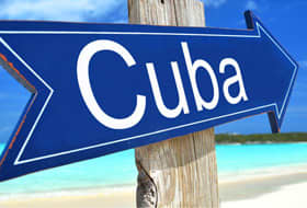 Sign pointing to Cuba