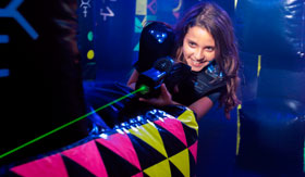 A girl enjoying laser tag