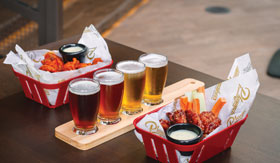 A flight of beer and wings at Playmakers