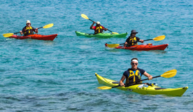 Kayaking from the Watersports Platform aboard Windstar's Star Breeze