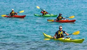 Kayaking from the Watersports Platform aboard Windstar's Star Legend