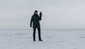 Photographer with camera in Antarctica