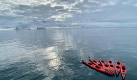 Group of Atlas Ocean Voyages kayaks in Antarctica
