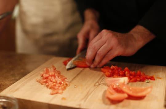 Chef cutting tomato