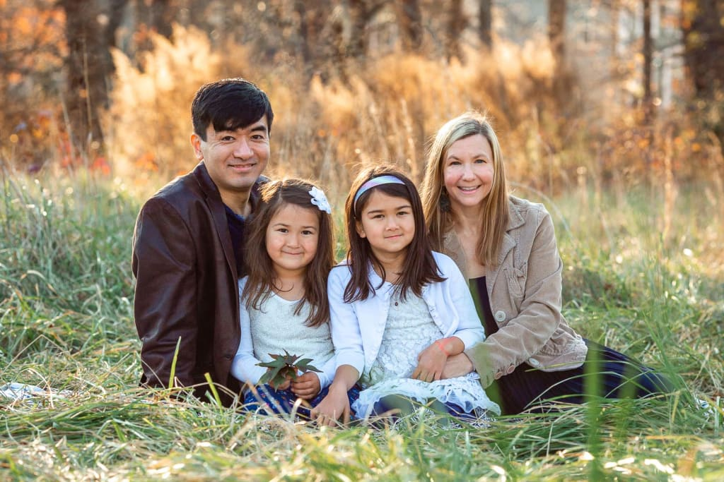 sunset photo session with family of 4 holly springs photographer