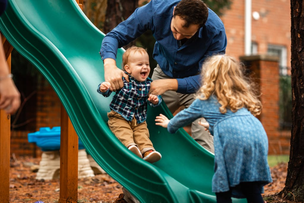 outdoor photoshoot with family of 4 raleigh family photographer