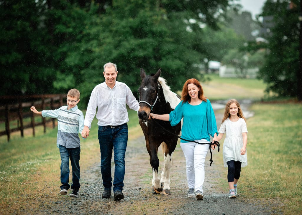 family photo shoot with a horse apex