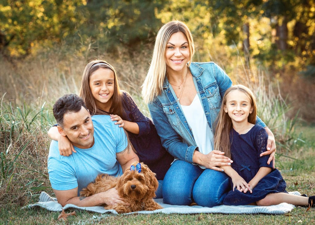 family of 4 with puppy posed family portrait holly springs