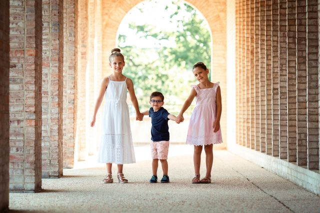 candid photographs of 3 siblings posing ideas durham kids photographer