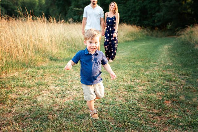 outdoor photo session with family of 3 at sugg farm park