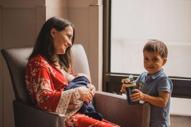 photographer for newborn photo session rex women's center