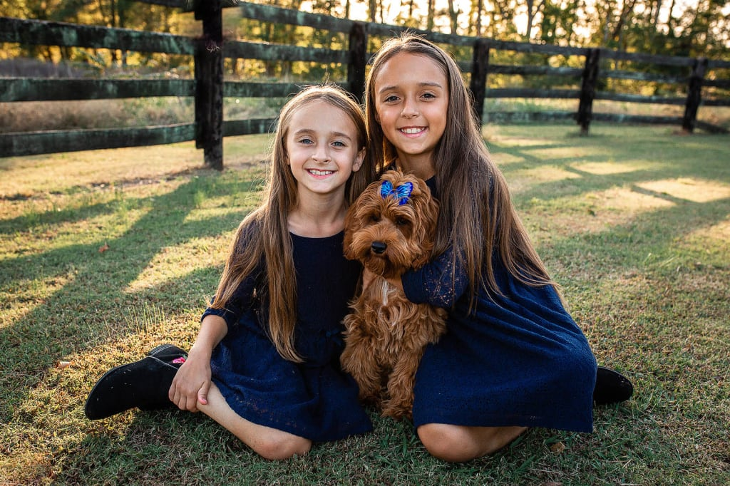 2 sisters with puppy photo shoot holly spring professional photographer