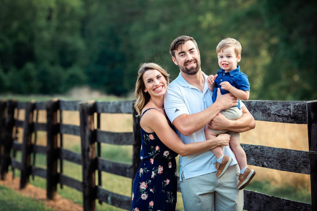 outdoor photo session with family of 3 holly springs photographer