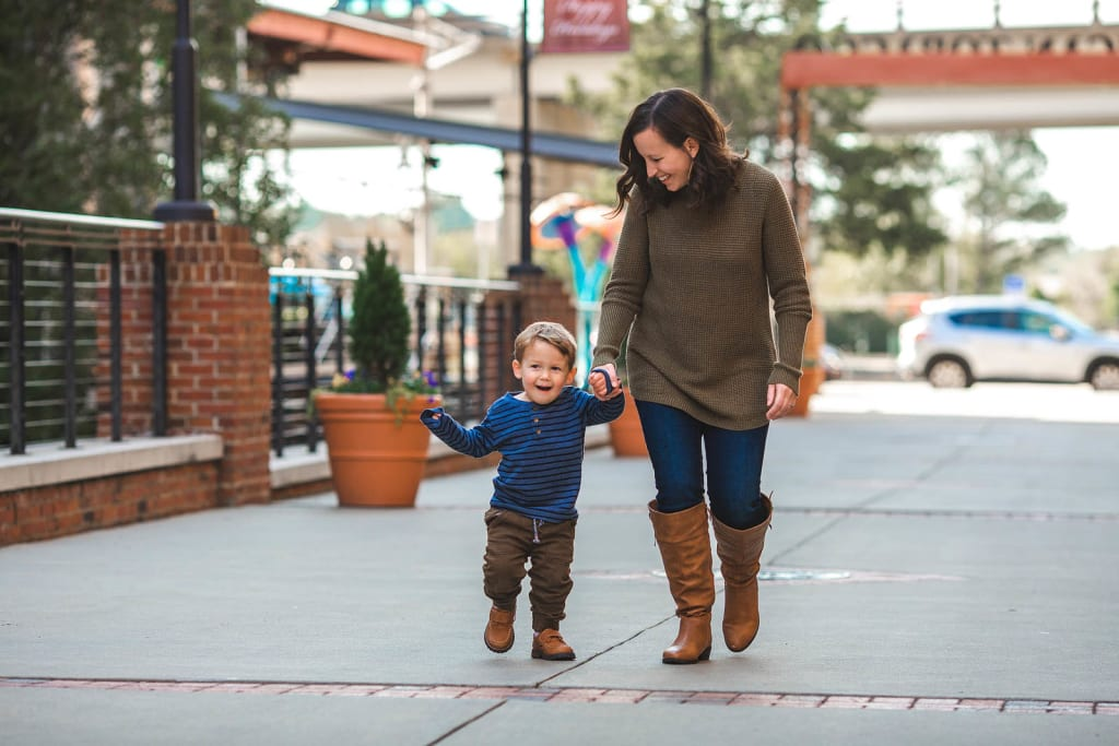 outdoor photo session with 2 years old boy durham family photographer