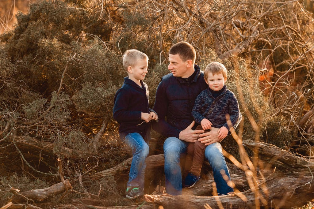 raleigh family photographer photo shoot at sugg farm par
