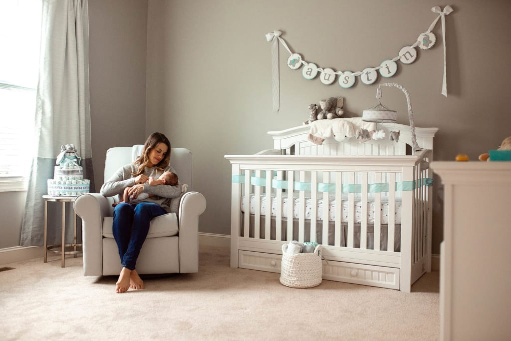 mommy and baby boy in nursery room raleigh newborn photographer