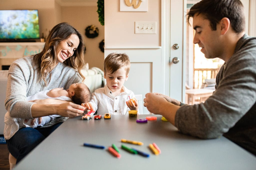 candid family portrait newborn photo session