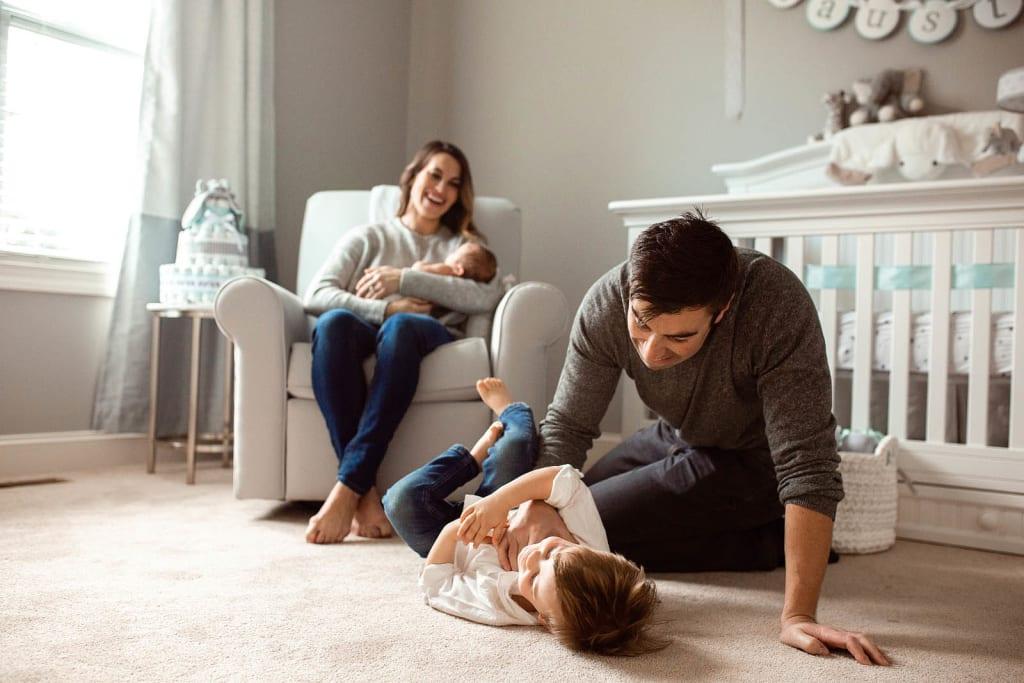 family portrait in nursery room newborn photoshoot raleigh newborn photographer