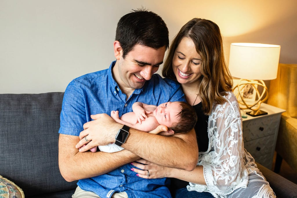 parents with newborn baby boy in-home photo session